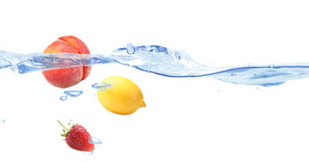 Juicy fruits dropped into water photo