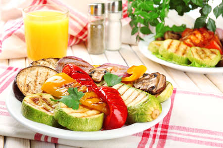 Delicious grilled vegetables on plate on table close-up photo