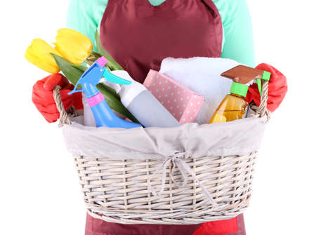 Housewife holding basket with cleaning equipment. Conceptual photo of spring cleaning. Isolated on white Stock Photo - 27010703