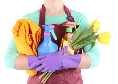 Housewife holding cleaning equipment in her hands. Conceptual photo of spring cleaning. Isolated on white Stock Photo - 27010704