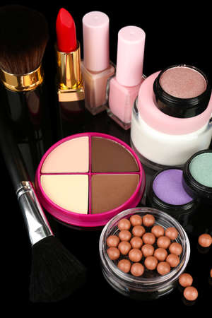 Professional make-up tools on black background photo