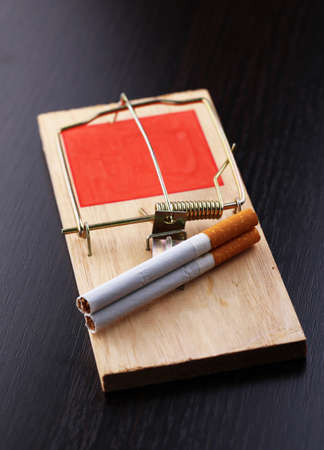 narcotism: Mousetrap with cigarette, isolated on white Stock Photo