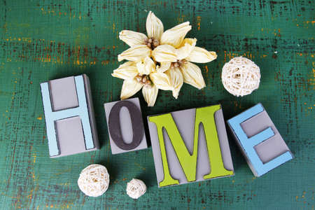 Composition with decorative letters on wooden background photo