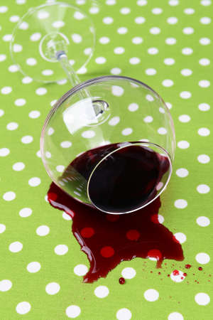 overturned: Overturned glass of wine on table close-up Stock Photo