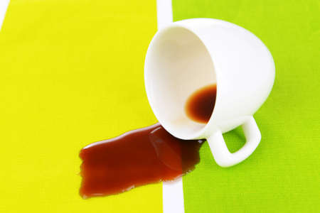 overturned: Overturned cup of coffee on table close-up Stock Photo