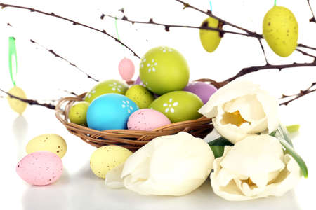 Easter composition with eggs branches close up photo