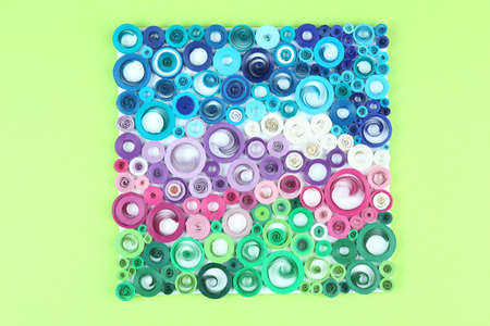 quilled shapes: Abstract colorful picture on green