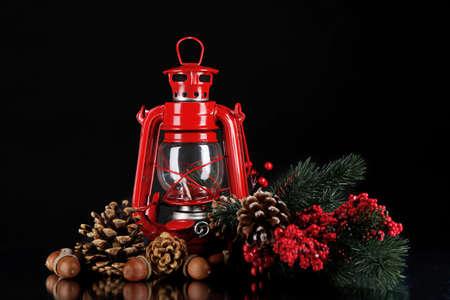 Red kerosene lamp on black  photo