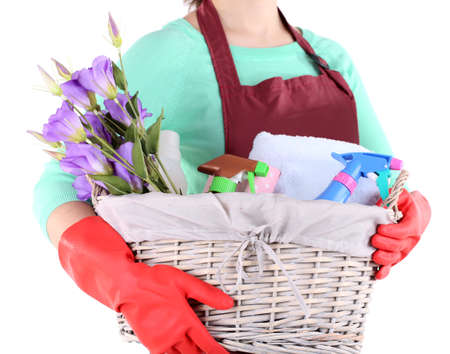 Housewife holding basket with cleaning equipment. Conceptual photo of spring cleaning. Isolated on white Stock Photo - 27035220