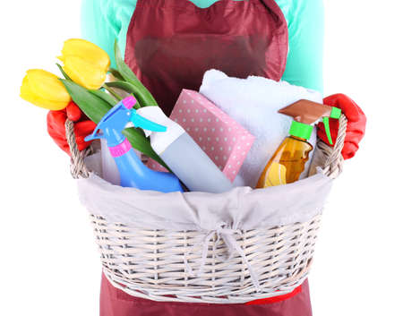 Housewife holding basket with cleaning equipment. Conceptual photo of spring cleaning. Isolated on white Stock Photo - 27035222