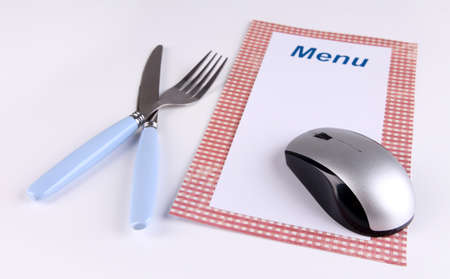 Computer mouse with menu and cutlery isolated on white photo