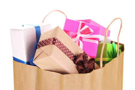 Presents in paper bag isolated on white photo