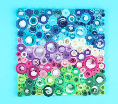 quilled shapes: Abstract colorful picture on blue background Stock Photo