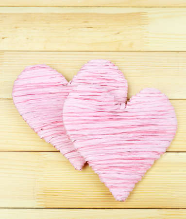 Decorative heart on wooden background photo