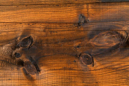 Brown wooden background, close up photo
