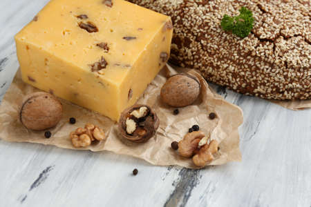 Tasty Italian cheese and bread on wooden table photo
