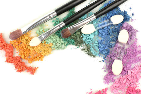 Rainbow crushed eyeshadow and professional make-up brush close up photo
