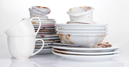 dirty dishes: Dirty dishes isolated on white