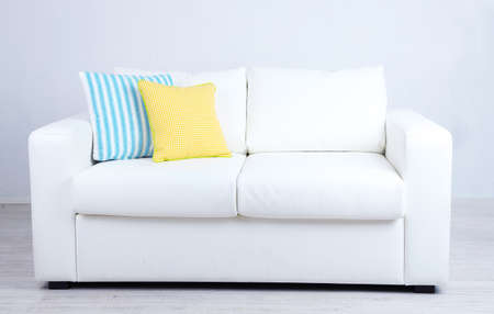 divan sofa: White sofa with colorful pillows in room