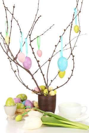 Easter composition with eggs on branches isolated on white photo