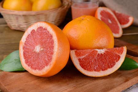 Ripe grapefruit on table close-up