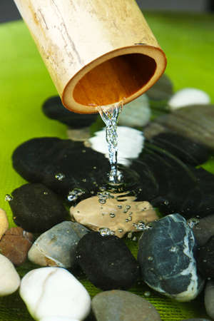 bamboo fountain: Spa still life with bamboo fountain and stones, close up