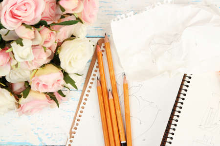 composition notebook: Composition with notebook and pencils on wooden table close-up Stock Photo