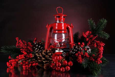 Red kerosene lamp on dark color background photo