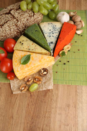 Different Italian cheese on wooden table photo