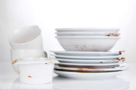 dirtiness: Dirty dishes isolated on white