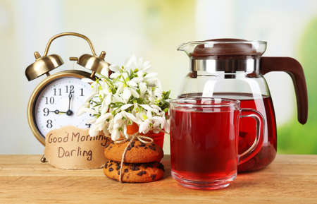 Tasty herbal tea and cookies on wooden table photo