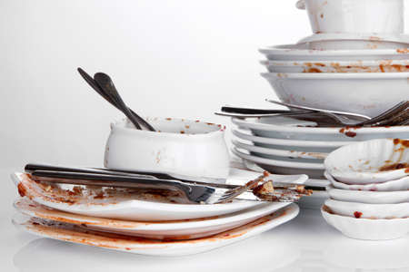multiple stains: Dirty dishes isolated on white