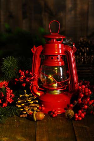 Red kerosene lamp on dark  photo