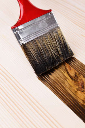 Applying protective varnish to wooden board close-up Stock Photo