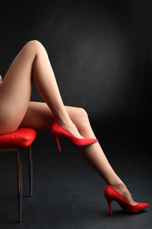 Stockings on perfect woman legs on dark  photo