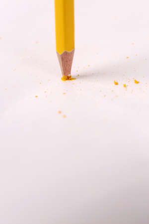 Breaking pencil, isolated on white photo