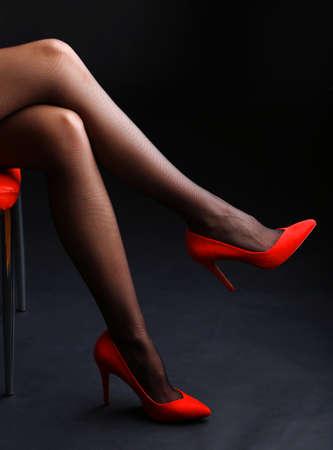 Stockings on perfect woman legs on dark  photo