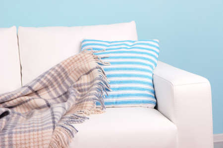 White sofa close-up in room on blue background Stock Photo - 27235348