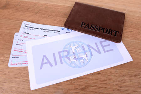 Airline tickets with passport on table close-up photo