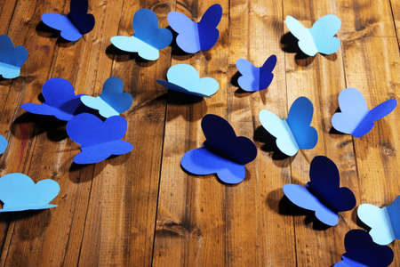 paper cut out: Paper cut out butterflies, on wooden background