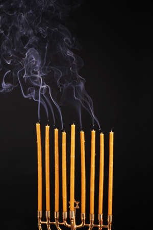 Smoke and extinct candles on dark background photo