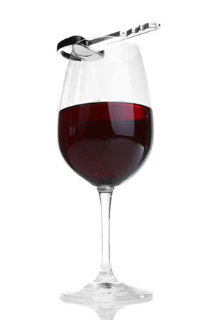 Composition with car key and glass of wine, isolated on white photo