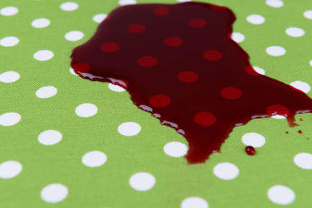 Spilled wine on tablecloth close-up photo