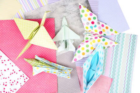 Origami figures and color papers, close up photo