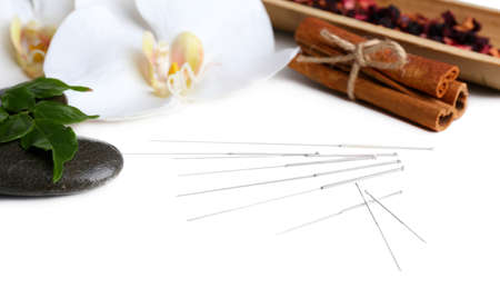 Composition with needles for acupuncture, isolated on white photo