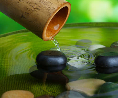 bamboo fountain: Spa still life with bamboo fountain, on bright background Stock Photo