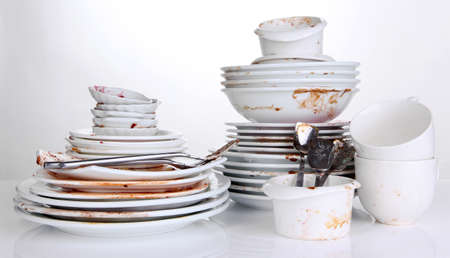 crockery: Dirty dishes isolated on white