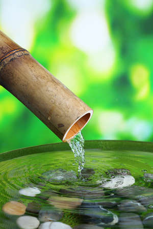 Spa still life with bamboo fountain, on bright background Stockfoto
