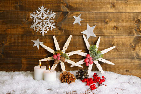 Christmas composition with snowflakes on wooden background photo