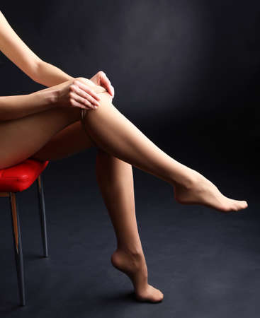 stocking feet: Stockings on perfect woman legs on dark background Stock Photo